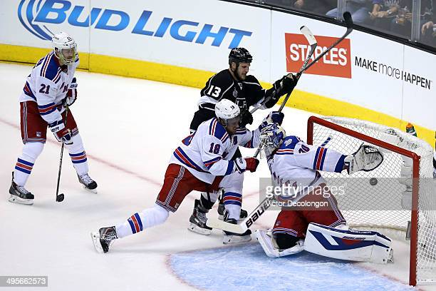 Kyle Clifford of the Los Angeles Kings scores a first period past goaltender Henrik Lundqvist of the New York Rangers during Game One of the 2014 NHL...