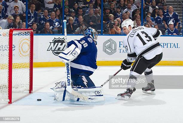 Kyle Clifford of the Los Angeles Kings scores a goal past Dwayne Roloson of the Tampa Bay Lightning at the Tampa Bay Times Forum on February 7 2012...