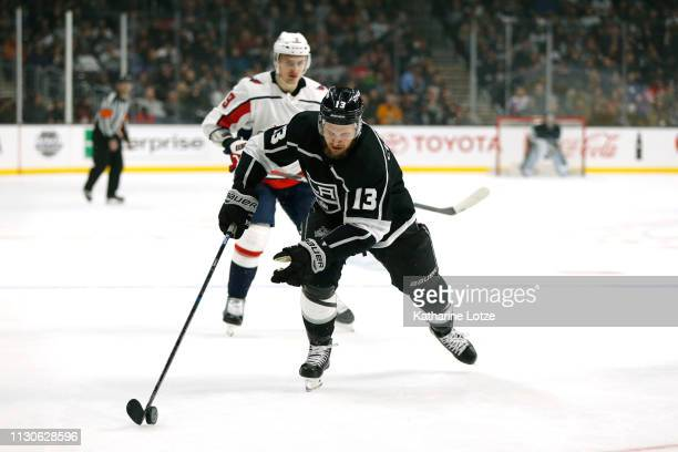 Kyle Clifford of the Los Angeles Kings takes the puck down the ice during the third period against the Washington Capitals at Staples Center on...