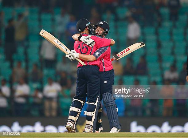 Kyle Coetzer and Matt Machan of Scotland celebrate their victory during the ICC Twenty20 World Cup Round 1 Group B match between Scotland and Hong...