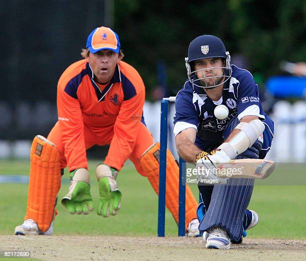 Kyle Coetzer of Scotland bats as J Smits of the Netherlands look on during the Netherlands v Scotland ICC World Twenty20 Cup Qualifier on August 4...