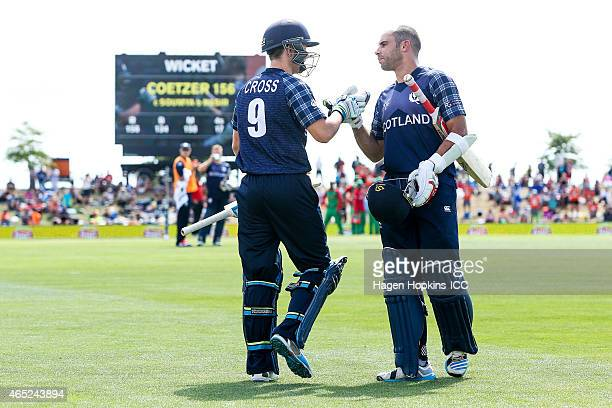 Kyle Coetzer of Scotland is acknowledged by teammate Matthew Cross after being dismissed for 156 off 134 balls during the 2015 ICC Cricket World Cup...