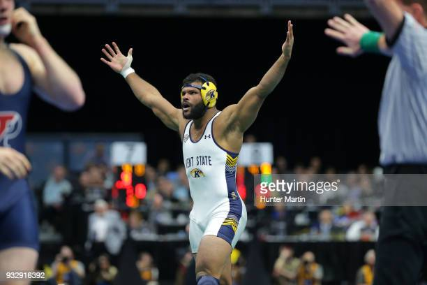 Kyle Conel of the Kent State Golden Flashes reacts after pinning the number one seeded Kollin Moore of the Ohio State Buckeyes during session three...