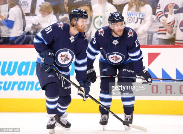 Kyle Connor and Paul Stastny of the Winnipeg Jets look on during the pregame warm up prior to NHL action against the Nashville Predators in Game Four...