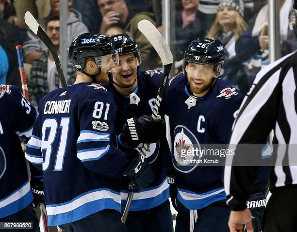 Kyle Connor Mark Scheifele and Blake Wheeler of the Winnipeg Jets are all smiles as they celebrate a first period goal against the Pittsburgh...