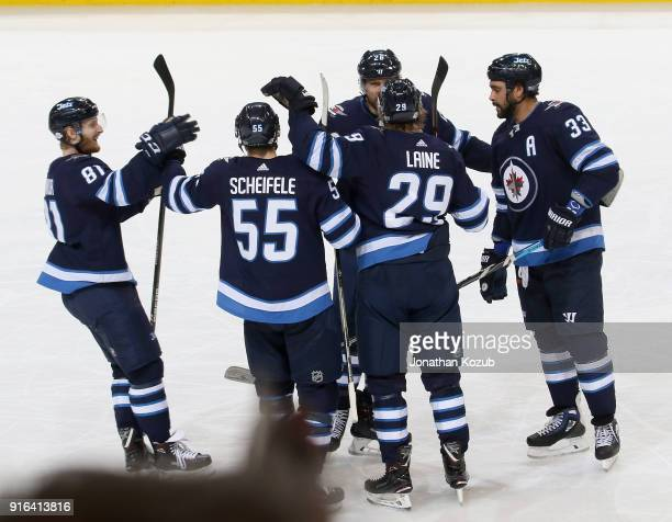 Kyle Connor Mark Scheifele Patrik Laine Blake Wheeler and Dustin Byfuglien of the Winnipeg Jets celebrate a third period goal against the St Louis...