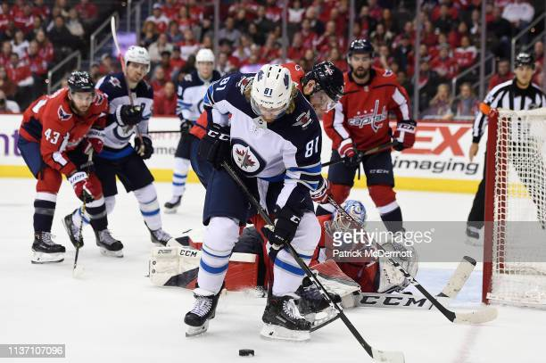 Kyle Connor of the Winnipeg Jets and John Carlson of the Washington Capitals battle for the puck in front of Pheonix Copley in the second period at...