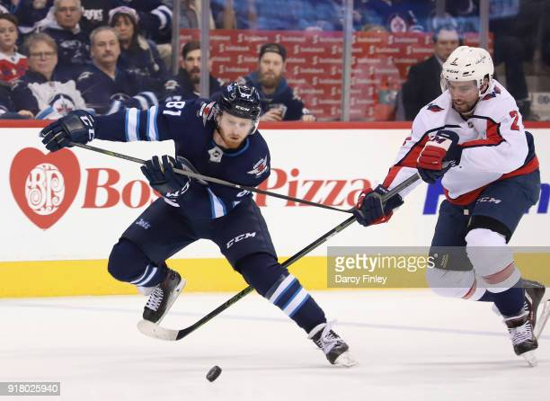 Kyle Connor of the Winnipeg Jets and Matt Niskanen of the Washington Capitals battle for the puck during second period action at the Bell MTS Place...