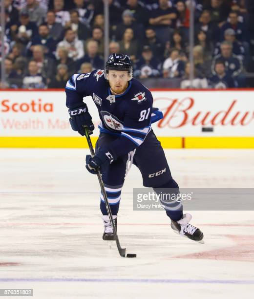 Kyle Connor of the Winnipeg Jets carries the puck down the ice during second period action against the Arizona Coyotes at the Bell MTS Place on...