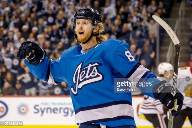 Kyle Connor of the Winnipeg Jets celebrates after scoring a first period goal against the Chicago Blackhawks at the Bell MTS Place on December 11...
