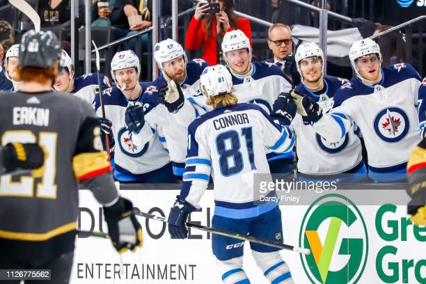 Kyle Connor of the Winnipeg Jets celebrates his first period goal against the Vegas Golden Knights with teammates at the bench at TMobile Arena on...