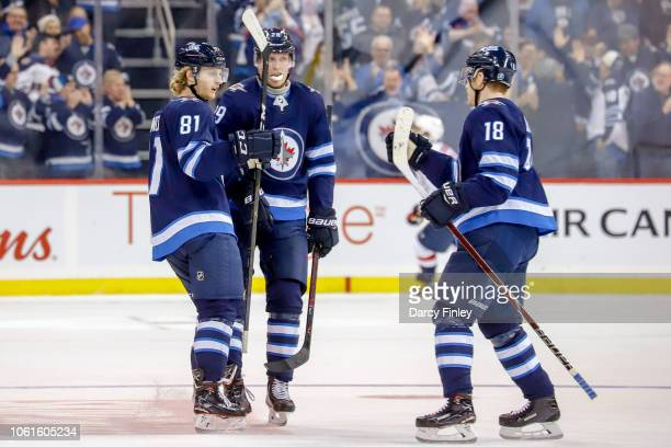 Kyle Connor of the Winnipeg Jets celebrates his third period goal against the Washington Capitals with teammates Patrik Laine and Bryan Little at the...
