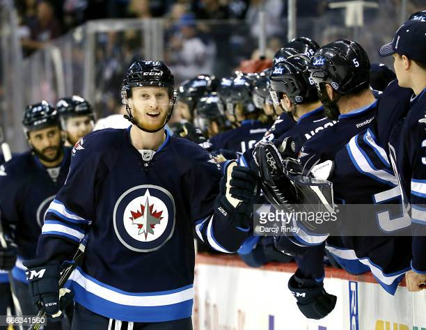 Kyle Connor of the Winnipeg Jets celebrates his third period goal against the Nashville Predators with teammates at the bench at the MTS Centre on...