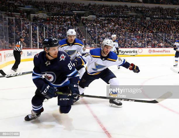 Kyle Connor of the Winnipeg Jets Colton Parayko and Vladimir Sobotka of the St Louis Blues follow the play towards the boards during second period...