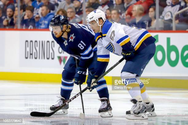 Kyle Connor of the Winnipeg Jets gets set against David Perron of the St Louis Blues during a first period faceoff at the Bell MTS Place on October...