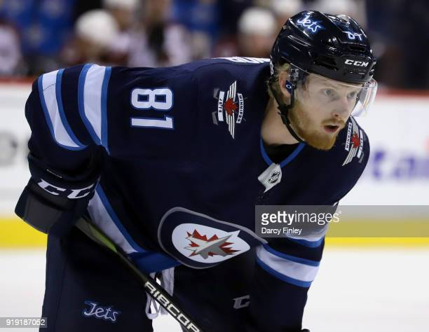 Kyle Connor of the Winnipeg Jets gets set for a first period faceoff against the Colorado Avalanche at the Bell MTS Place on February 16 2018 in...