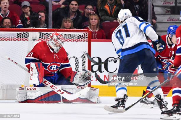 Kyle Connor of the Winnipeg Jets gets the puck past goaltender Carey Price of the Montreal Canadiens and scores in overtime during the NHL game at...