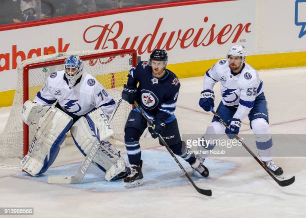 Kyle Connor of the Winnipeg Jets goaltender Louis Domingue and Braydon Coburn of the Tampa Bay Lightning keep an eye on the play during third period...