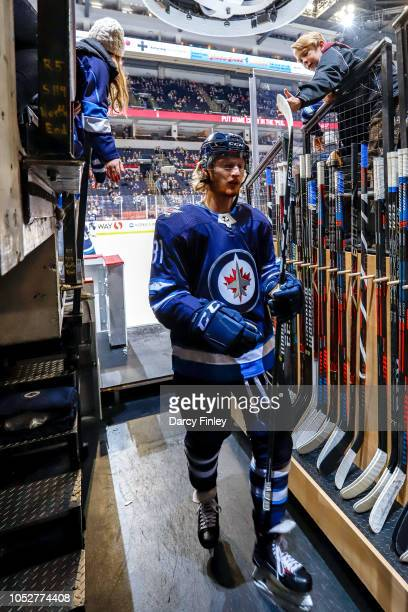 Kyle Connor of the Winnipeg Jets heads off the ice following the pregame warm up prior to NHL action against the St Louis Blues at the Bell MTS Place...