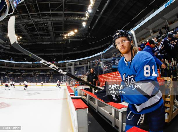 Kyle Connor of the Winnipeg Jets heads to the ice for the start of the pregame warm up prior to NHL action against the Colorado Avalanche at the Bell...