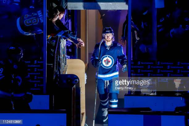 Kyle Connor of the Winnipeg Jets heads to the ice prior to NHL action against the New York Rangers at the Bell MTS Place on February 12 2019 in...
