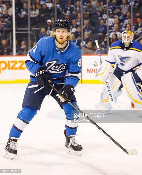 Kyle Connor of the Winnipeg Jets keeps an eye on the play during first period action against the St Louis Blues at the Bell MTS Place on December 7...