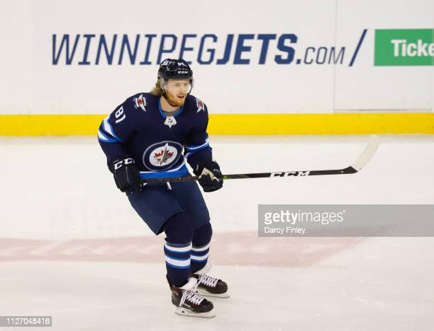 Kyle Connor of the Winnipeg Jets keeps an eye on the play during second period action against the Columbus Blue Jackets at the Bell MTS Place on...