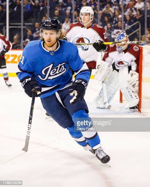 Kyle Connor of the Winnipeg Jets keeps an eye on the play during first period action against the Colorado Avalanche at the Bell MTS Place on February...