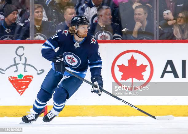 Kyle Connor of the Winnipeg Jets keeps an eye on the play during first period action against the New York Islanders at the Bell MTS Place on March 28...