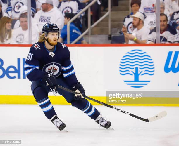 Kyle Connor of the Winnipeg Jets keeps an eye on the play during first period action against the St Louis Blues in Game Five of the Western...