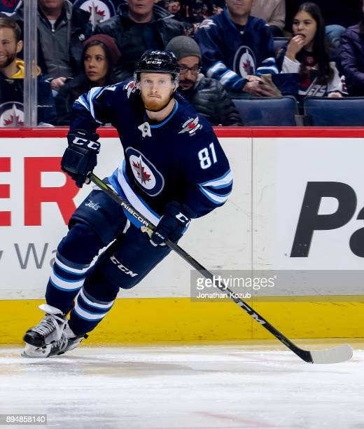 Kyle Connor of the Winnipeg Jets keeps an eye on the play during first period action against the Vancouver Canucks at the Bell MTS Place on December...