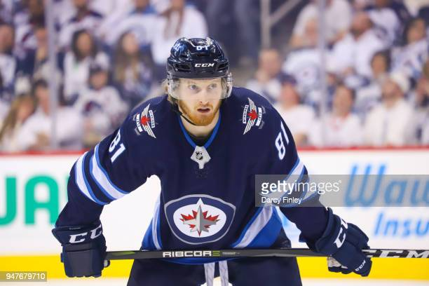 Kyle Connor of the Winnipeg Jets looks on as he awaits a first period faceoff against the Minnesota Wild in Game Two of the Western Conference First...