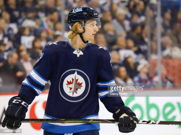 Kyle Connor of the Winnipeg Jets looks on during a second period stoppage in play against the Colorado Avalanche at the Bell MTS Place on November 9...