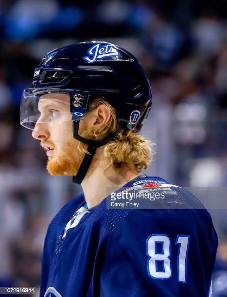 Kyle Connor of the Winnipeg Jets looks on during a second period stoppage in play against the Edmonton Oilers at the Bell MTS Place on December 13...