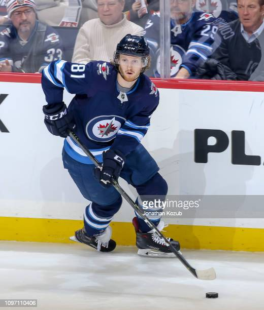 Kyle Connor of the Winnipeg Jets plays the puck along the boards during third period action against the Vegas Golden Knights at the Bell MTS Place on...