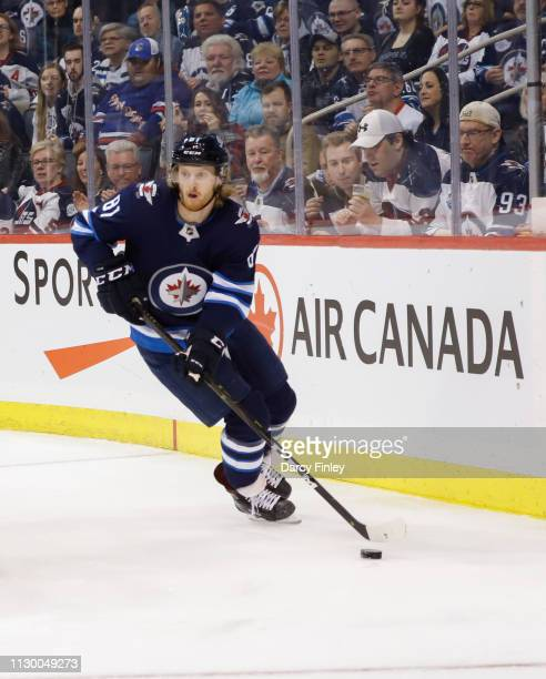 Kyle Connor of the Winnipeg Jets plays the puck along the boards during third period action against the New York Rangers at the Bell MTS Place on...
