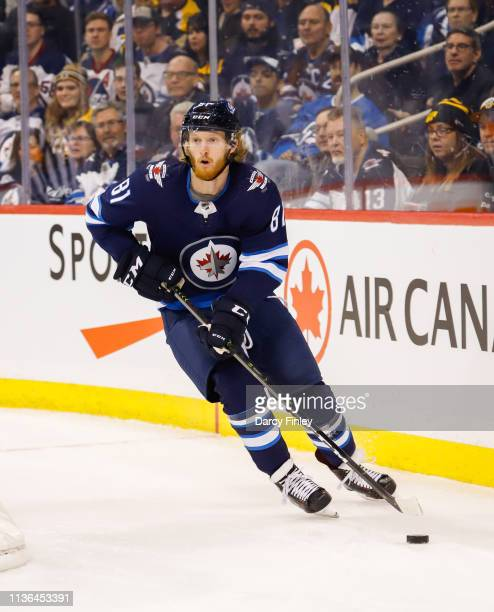Kyle Connor of the Winnipeg Jets plays the puck around the boards during first period action against the Boston Bruins at the Bell MTS Place on March...