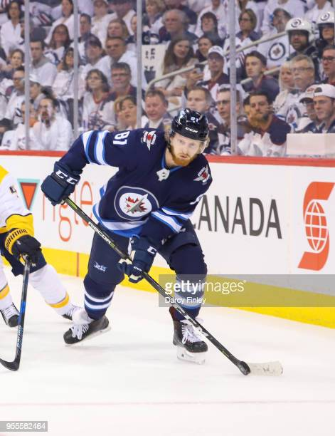 Kyle Connor of the Winnipeg Jets plays the puck around the boards during first period action against the Nashville Predators in Game Four of the...
