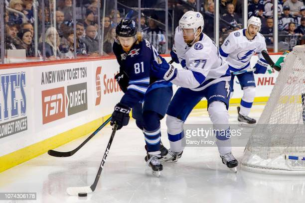 Kyle Connor of the Winnipeg Jets plays the puck around the net as Victor Hedman of the Tampa Bay Lightning defends during second period action at the...