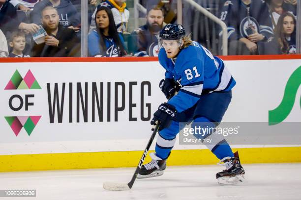 Kyle Connor of the Winnipeg Jets plays the puck down the ice during second period action against the Pittsburgh Penguins at the Bell MTS Place on...