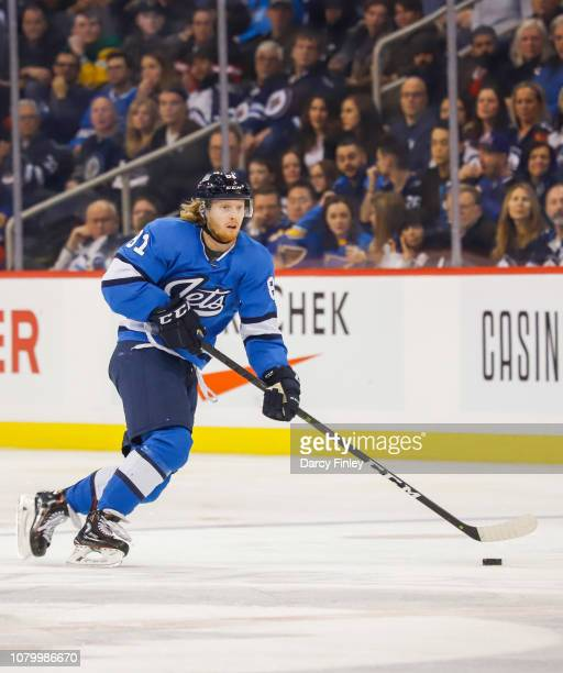 Kyle Connor of the Winnipeg Jets plays the puck down the ice during third period action against the St Louis Blues at the Bell MTS Place on December...