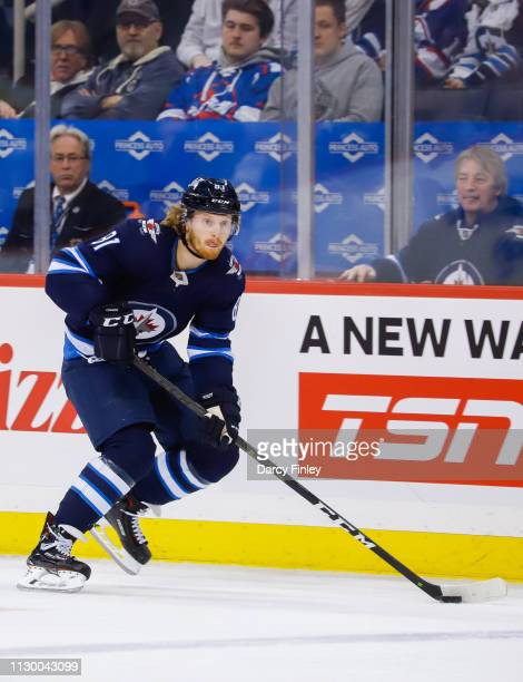 Kyle Connor of the Winnipeg Jets plays the puck down the ice during first period action against the New York Rangers at the Bell MTS Place on...