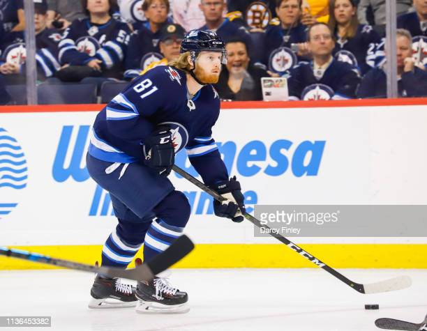 Kyle Connor of the Winnipeg Jets plays the puck down the ice during first period action against the Boston Bruins at the Bell MTS Place on March 14...