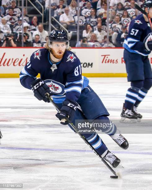 Kyle Connor of the Winnipeg Jets plays the puck down the ice during second period action against the St Louis Blues in Game Five of the Western...