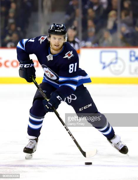 Kyle Connor of the Winnipeg Jets plays the puck down the ice during first period action against the Vancouver Canucks at the Bell MTS Place on...