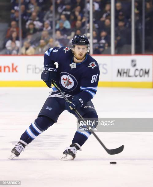 Kyle Connor of the Winnipeg Jets plays the puck down the ice during first period action against the Arizona Coyotes at the Bell MTS Place on February...