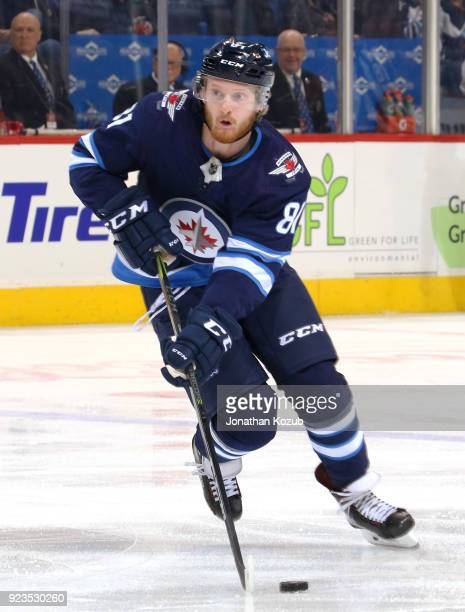 Kyle Connor of the Winnipeg Jets plays the puck down the ice during second period action against the Florida Panthers at the Bell MTS Place on...