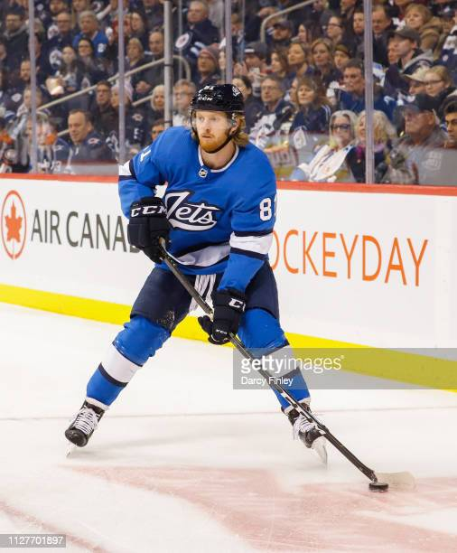 Kyle Connor of the Winnipeg Jets plays the puck during first period action against the Anaheim Ducks at the Bell MTS Place on February 2 2019 in...