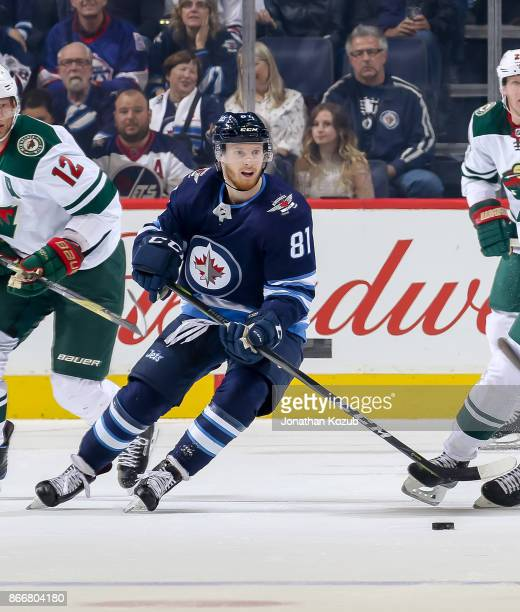 Kyle Connor of the Winnipeg Jets plays the puck during first period action against the Minnesota Wild at the Bell MTS Place on October 20 2017 in...