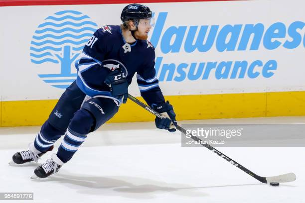Kyle Connor of the Winnipeg Jets plays the puck during second period action against the Nashville Predators in Game Three of the Western Conference...